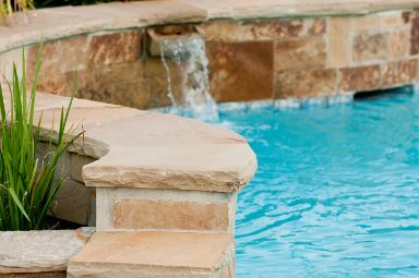 Luxurious-swimming-pool-with-stone-waterfall at hoppers crossing pavers