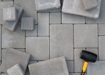 concrete-paving-wtih-hammer at hoppers crossin pavers