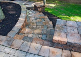 travertine pavers installed in a garden at hopper crossing pavers